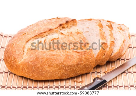 Sliced wheat bread. Isolated on white background - stock photo