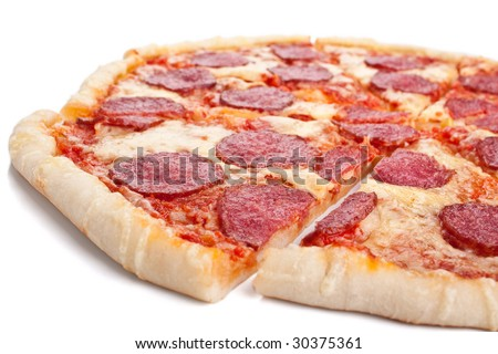sliced whole salami pizza on white background - stock photo