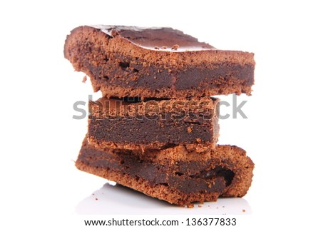 Slices of a brownie on white background - stock photo
