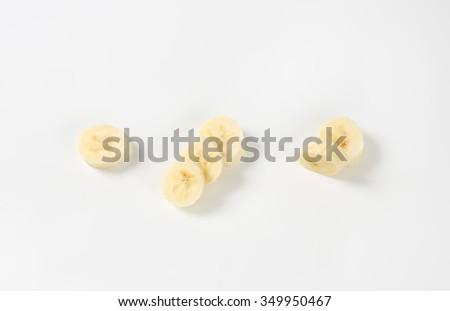 slices of banana on white background - stock photo