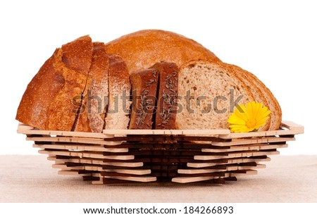 Slices of bread on a decorative dish over white background - stock photo