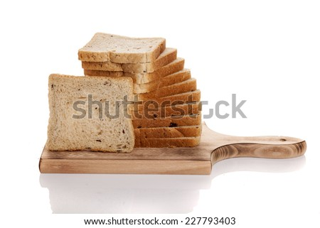 slices of bread on a wooden board - stock photo