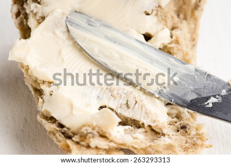 Slices of bread with creamy cheese spread - stock photo