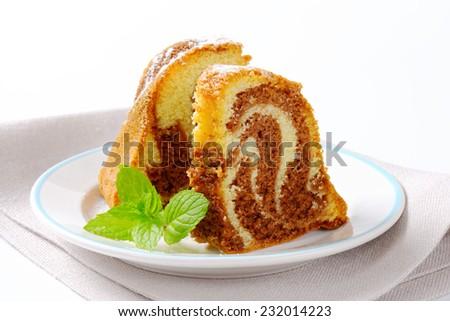 Slices of chocolate marble cake on white background - stock photo