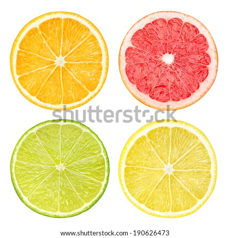 Slices of citrus fruits isolated on white - stock photo