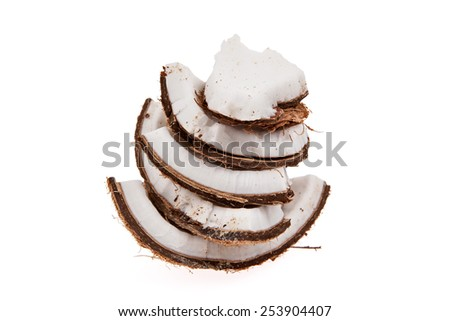 Slices of coconut in a stacked formation isolated on white - stock photo