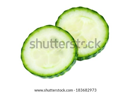 Slices of cucumber isolated on white background with clipping path - stock photo