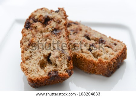 Slices of delicious banana bread on a white plate - stock photo