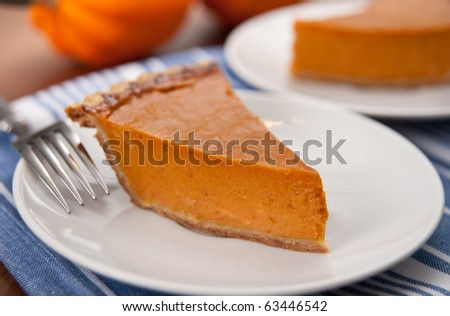 Slices of Delicious Fresh Pumpkin Pie - stock photo