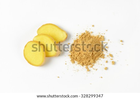 slices of fresh ginger and heap of ground ginger spice on white background - stock photo