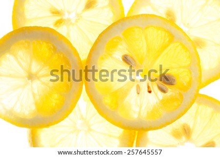 Slices of fresh lemon isolated on white background - stock photo