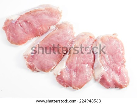 slices of fresh meat with spices - stock photo