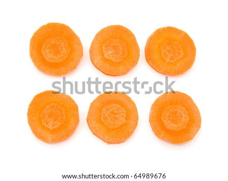 Slices of fresh organic carrot over white background - stock photo
