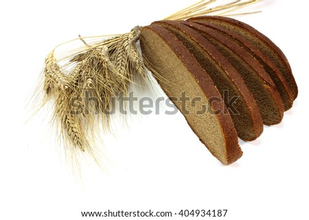 Slices of fresh rye bread and ears - stock photo