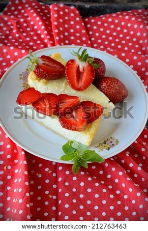 Slices of Freshly Baked Cheese Cake with Strawberries - stock photo