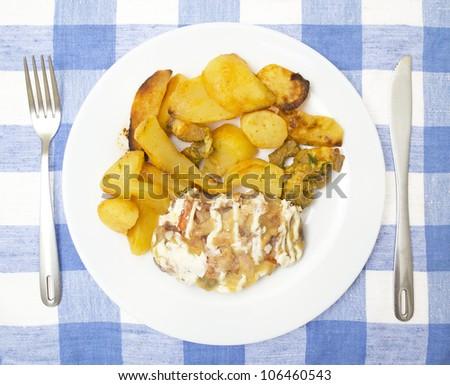 slices of fried potato  with pork - stock photo