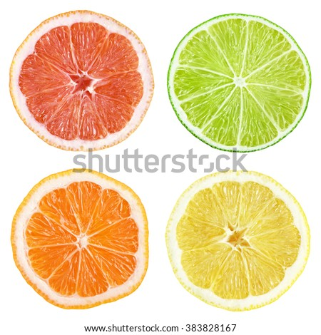 Slices of grapefruit, lime, lemon, orange isolated on white with clipping path - stock photo