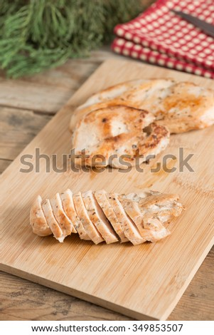Slices of grilled chicken breast. - stock photo