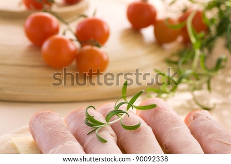 Slices of ham and cheese with rosemary - stock photo