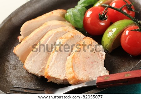 Slices of pan roasted chicken breast - detail - stock photo