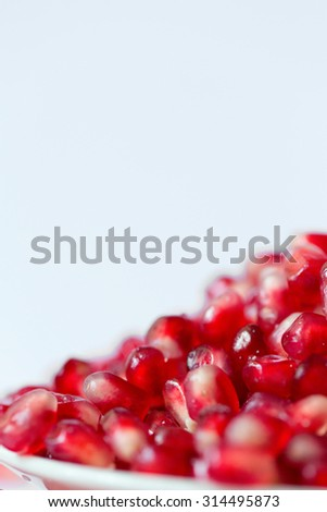 Slices of pomegranate close-up. - stock photo