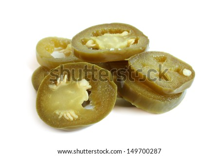 Slices of preserved Jalapeno pepper on a white background - stock photo