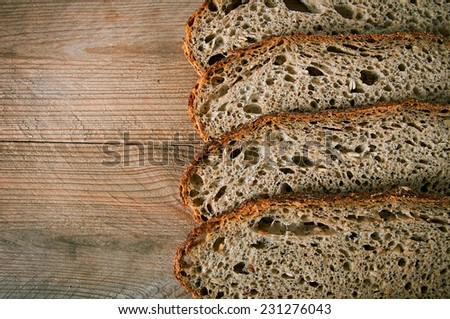 slices of rye bread on the wooden table - stock photo