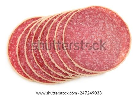 Slices of salami isolated on white background - stock photo