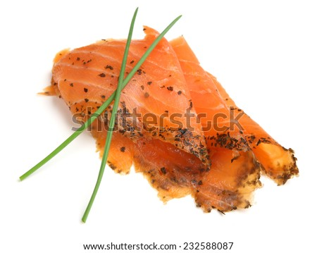Slices of smoked salmon with basil and lemon oil. - stock photo