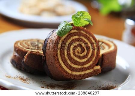 Slices of sponge cake roll  - stock photo