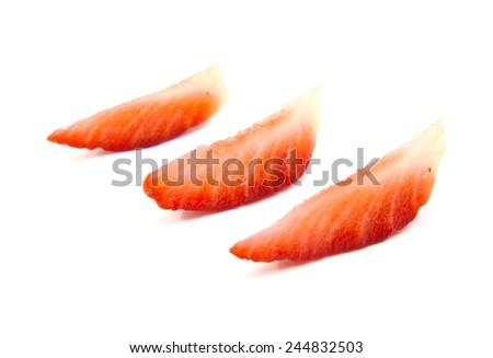 Slices of strawberry on white background - stock photo