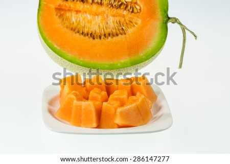 Slices of succulent Orange melon lie on a plate - stock photo