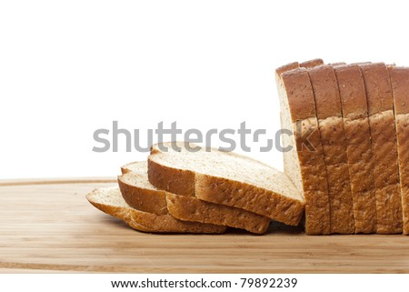 Slices of wheat bread against a white background - stock photo