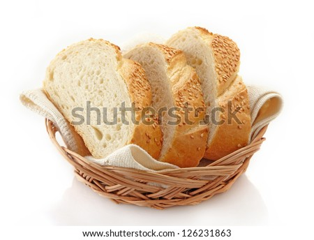 Slices of white bread in basket - stock photo