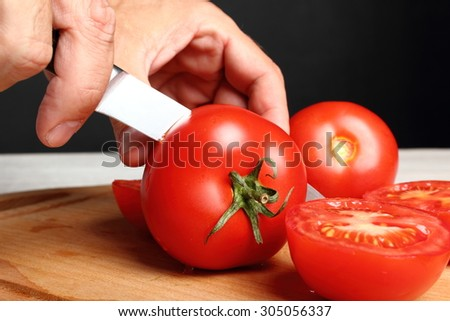 Slicing tomatoes - stock photo