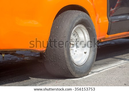 Slick tyre for drag racing car - stock photo