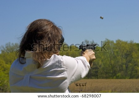 slide on a polymer handgun reaching lock back - stock photo