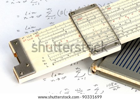 Slide rule close up with work sheet - stock photo
