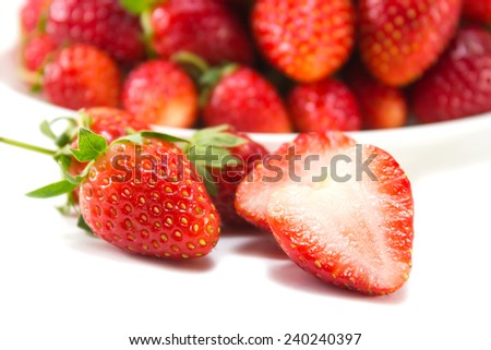 Slide strawberry with strawberry on white plate background. White background. - stock photo