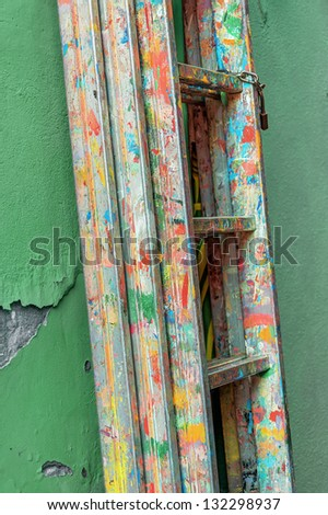 Sliding ladder of the artist's house-painting - Burano, Venice, Italy - stock photo
