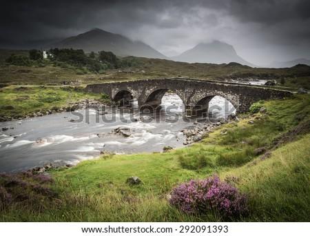Sligachan, Isle of Skye, Scotland. Sligachan bridge during a very cloudy day. - stock photo