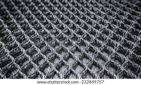 Slightly defocused and closeup of steel mesh and wire texture - stock photo