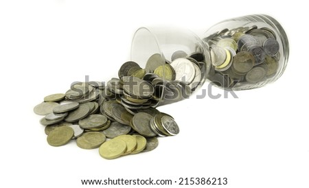 Slightly defocused Malaysia gold coins or small change in transparent hourglass. - stock photo