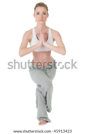 Slim attractive young woman doing yoga, eagle / garudasana position, isolated on white background - stock photo