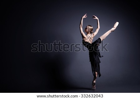 Slim ballerina is dancing in the dark - stock photo