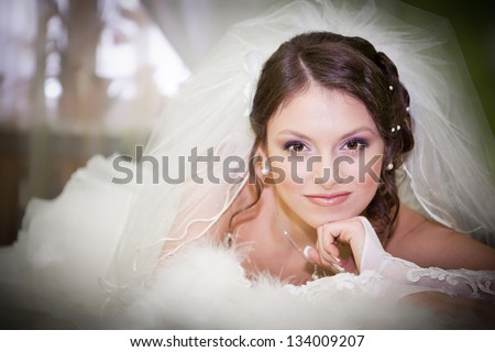 Slim beautiful woman wearing luxurious wedding dress - stock photo