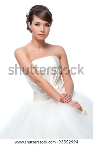 Slim beautiful woman  wearing luxurious wedding dress. Bride - stock photo