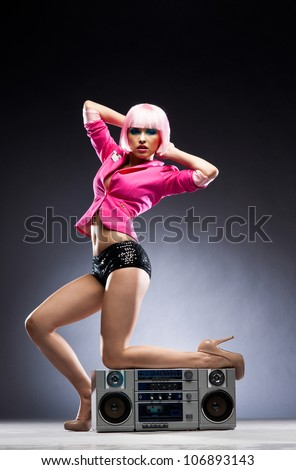Slim beauty with a tape recorder - stock photo