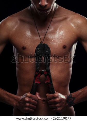 slim Fitness model posing in  studio with a tool - stock photo