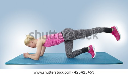 Slim fitness young woman Athlete girl doing plank exercise training workout. - stock photo